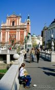 Travel photography:One of the bridges of Tromostovje (triple bridges) with the Franciscan church and Prešeren Square in Ljubljana, Slovenia