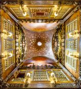 Travel photography:Looking up in the central hall of Palau Güell, Spain