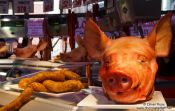 Travel photography:Pig´s heads and saussage for sale at the Bilbao food market, Spain