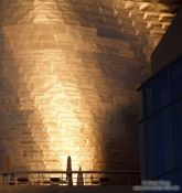 Travel photography:Evening light hits the facade of the Bilbao Guggenheim Museum, Spain