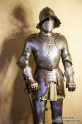 Travel photography:Full body suit of armour on display in the Alcazar castle in Segovia, Spain