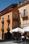 Travel photography:Houses on the plaza mayor in Begur, Spain