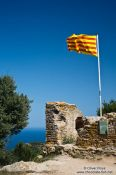Travel photography:Catalan flag on top of Begur castle, Spain
