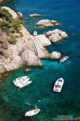 Travel photography:Boats in a small bay along the Costa Brava, Spain