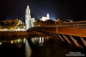 Travel photography:Bridge crossing the Onyar river in Girona with cathedral, Spain