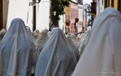 Travel photography:White head scarfs worn by women during the Good Friday procession in Las Palmas, Spain