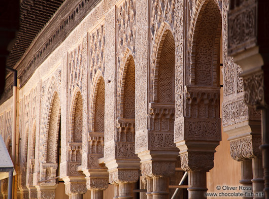 Arches in the Patio de los Leones (Court of the Lions) of the Nazrin palace in the Granada Alhambra