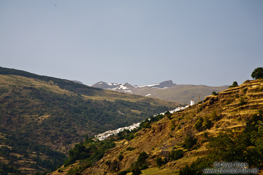 View of Capileira village with snow capped Pico Veleta in the background