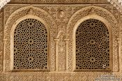 Travel photography:Ornate arabesque windows in the Nazrin palace of the Granada Alhambra, Spain