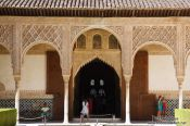 Travel photography:Arches in the patio de los Arrayanes (Court of the Myrtles), also called the Patio de la Alberca (Court of the Blessing or Court of the Pond) in the Nazrin palace of the Granada Alhambra, Spain