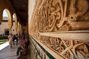 Travel photography:Facade detail in the Patio de los Arrayanes (Court of the Myrtles), also called the Patio de la Alberca (Court of the Blessing or Court of the Pond) in the Nazrin palace of the Granada Alhambra, Spain