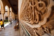 Travel photography:Arabesque facade detail in the Patio de los Arrayanes (Court of the Myrtles), also called the Patio de la Alberca (Court of the Blessing or Court of the Pond) in the Nazrin palace of the Granada Alhambra, Spain