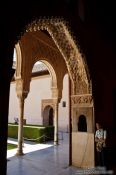 Travel photography:Arches in Patio de los Arrayanes (Court of Myrtles) of the Nazrin palace in Granada`s Alhambra, Spain