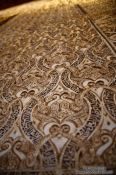 Travel photography:Arabesque wall decoration the the Sala de los Abencerrajes (Hall of the Abencerrages) in the Nazrin palace of the Granada Alhambra, Spain