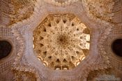Travel photography:Arabesque ceiling in the Sala de los Abencerrajes (Hall of the Abencerrages) of the Nazrin palace in the Granada Alhambra, Spain