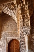 Travel photography:Facade detail in the Patio de los Leones (Court of the Lions) of the Nazrin palace in the Granada Alhambra, Spain