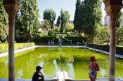 Travel photography:Portico and pool of the early 14th-century Partal, in the Alta Alhambra in Granada, Spain