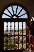 Travel photography:View of Granada through a window at the Generalife of the Granada Alhambra, Spain