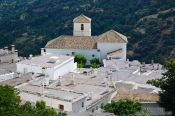 Travel photography:Panoramic view of the Pampaneira village centre and church, Spain
