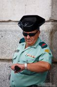 Travel photography:Bored policeman in Madrid, Spain