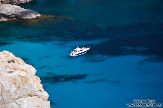 Anchored boat in a bay near Cap Formentor