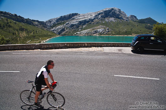 Cyclist at the Embassament de Cuber water reservoir in the Serra de Tramuntana mountains