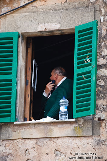 Man shaving at open window in Valldemossa village