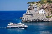 Travel photography:Port de Soller light house and tourist boat, Spain