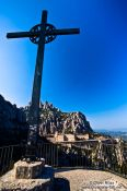 Travel photography:Giant cross on a mountain opposite the Montserrat monastery, Spain