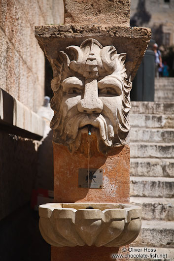 Sculpted stone fountain in Palma