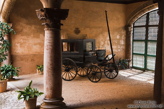 Old horse cart inside a classical baroque patio in a Palma house