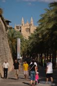 Travel photography:Promenade along the sea side of Palma with the cathedral La Seu in the background, Spain