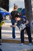 Travel photography:Woman playing boules in Palma, Spain