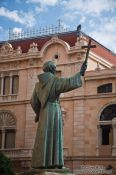 Travel photography:Statue of Juniper Serra outside the Basilica St Francesc in Palma, Spain