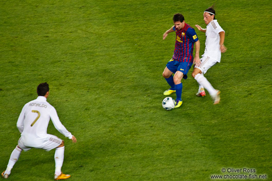 Tackle by Özil against Messi with Cristiano Ronaldo