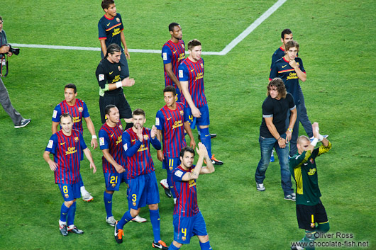 The team of FC Barcelona with new arrival Cesc Fábregas on their victory lap after winning the Supercup 2011