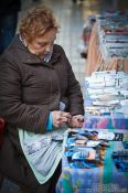 Travel photography:A stall keeper is counting her money in Valencia, Spain