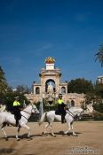 Travel photography:Mounted police patrol in front of the Cascada in Barcelona´s Parc de la Ciutadella, Spain