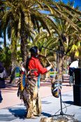 Travel photography:Busker at the Barcelona beach front, Spain