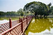 Travel photography:Lake with bridge and island at the Sukhothai temple complex, Thailand