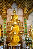 Travel photography:Row of Buddha statues at a temple in Bangkok, Thailand