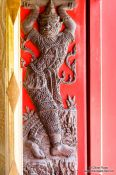 Travel photography:Sculpture in a window shutter at Wat Benchamabophit in Bangkok, Thailand
