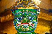 Travel photography:Golden demon sculpture at Wat Phra Kaew, the Bangkok Royal Palace, Thailand