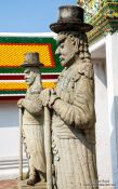 Travel photography:Stone guardians at Wat Pho temple in Bangkok, Thailand
