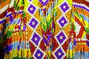 Travel photography:Detail of tradition dress in Trang, Thailand
