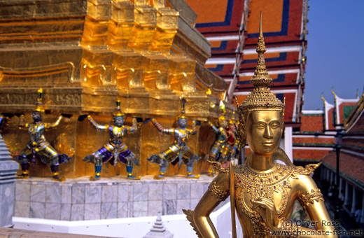 Golden Kinnara with demons Wat Phra Kaew in Bangkok