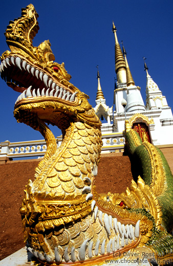 Dragon-eat-dragon figure at a temple in Chiang Rai province