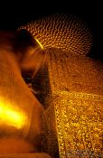 Travel photography:The neck part of the giant reclining Buddha at Wat Pho, Thailand