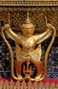 Travel photography:Golden Garuda figure at Wat Phra Kaew in Bangkok, Thailand