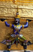 Travel photography:Demon figure at Wat Phra Kaew in Bangkok, Thailand